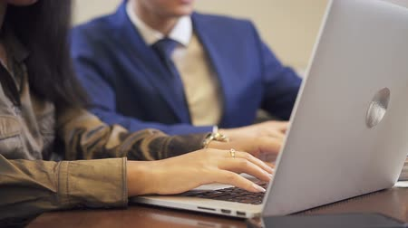 solicitor : African solicitor is answering on client question and advice good financial strategy. Lawyer is expert of networking information, she compare it with her laptop and emphisize some important professional points for businessman.