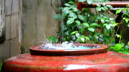 regenwater : rain drop to big water jar to use in the dry season in rural country