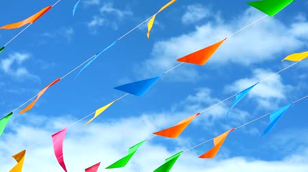 spousta : colorful triangular flag line moving by wind on blue sky white cloud1