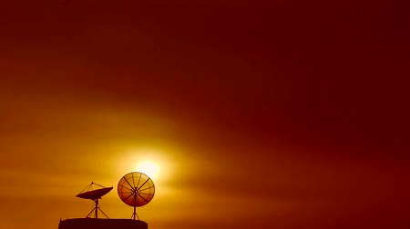 microonda : time lapse blur sunset back silhouette two satellite dish