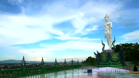 budha : pearl buddha stand on two naga on mountain white cloud on sky time lapse Stock Footage