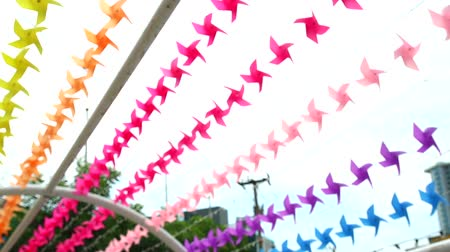 pino : blur rainbow windmill toy is decorated at shopping mall to welcome summer Stock Footage