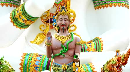 divinity : Close up to Srisuttho god of Naga and buddha background at Khao Mai Kaew Temple Stock Footage