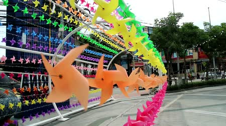 barbante : rainbow color windmill toy is decorated at shopping mall to welcome summer