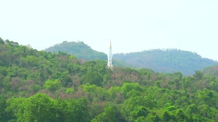 saygı : top of gold white pagoda on mountain at Tham Prathun temple