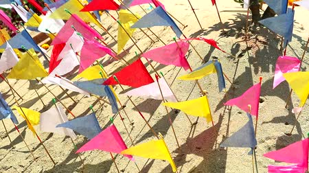 bem aventurança : Many colored triangles were embroidered on sand around pagoda