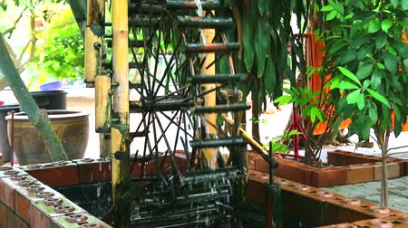 caseiro : water wheel made of bamboo decorated in the garden