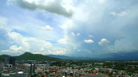 arriving : blue and storm cloud over city and mountain and hill time lapse Stock Footage