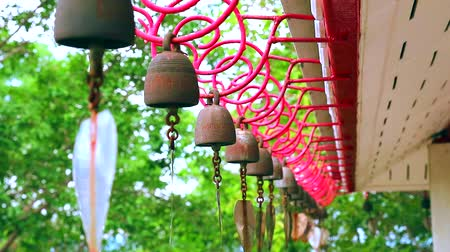 стучать : Bells hanging in a row by wind roof of temple