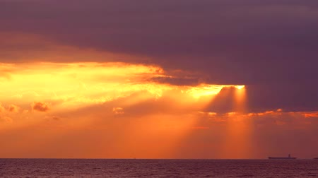 petroleiro : god bless of sunlight sunset back on orange cloud on sea Vídeos