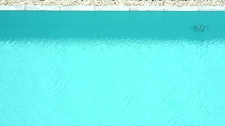 уродливый : swimming pool and wall tide under aqua color water and little waveon surface