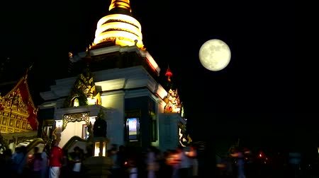 puja : full blood moon moving beside pagoda on Asalha Puja Day time lapse Stock Footage