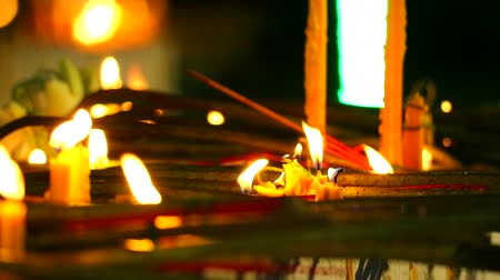 fazla : fire on short candle for worship Lord Buddha and blur much candle background