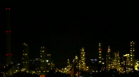 poluir : multicolor and rainbow night light of oil refinery  and chimney1