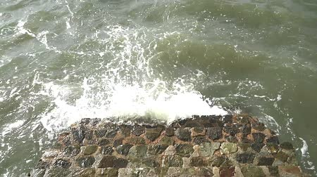 ferida : wave surge with stone stair on sea in storm season