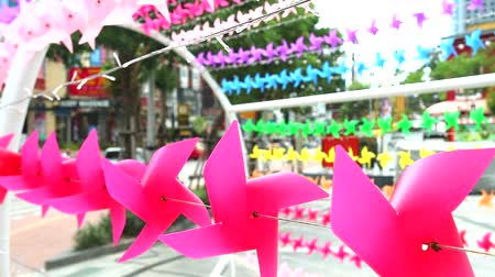 lapát : pink windmill toy is decorated at shopping mall rainbow wingmill background