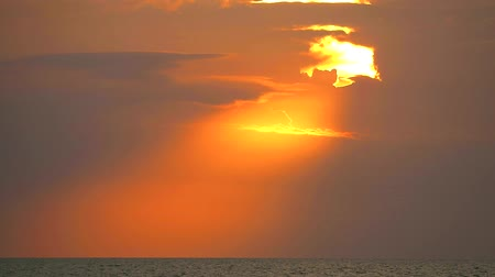 petroleiro : sunset and sun ray back on cloud orange sky over the sea