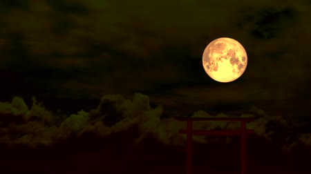 holdfény : blood moon moving pass back torii wood and cloud on dark night sky Stock mozgókép