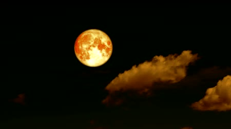 gerçeküstü : blood harvest moon pass rolling cloud on night sky time lapse