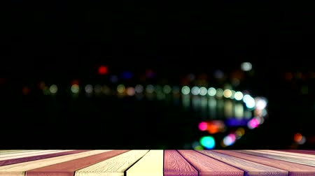 dividindo : wood top table and blur bokeh night light of pattaya city and beach road Stock Footage
