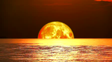 perigee : super full beaver blood moon move on night sky over wave on water in the sea Stock Footage