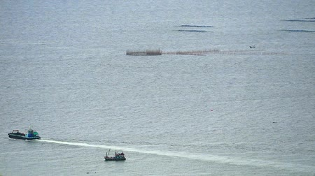 midye : fishing boat sailed at sea to search for fish and seafood passing the oyster farm