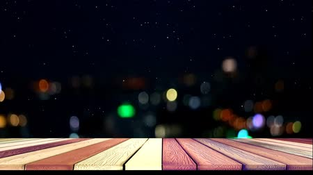 dividindo : top wood table and blur night light of city and snow
