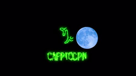 libra : capricorn text saber effect and zodiac symbol is slowing appear full moon Stock Footage
