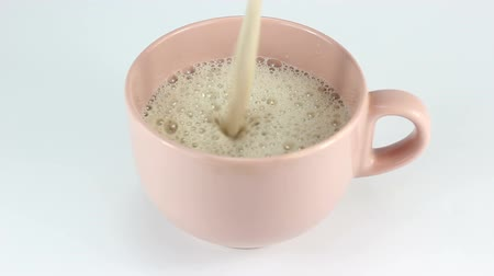 pouring : Pouring coffee milk into cup