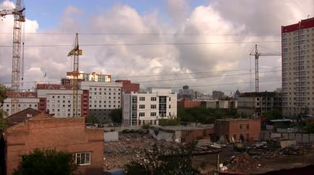 truck crane : Time lapse view of the construction site with three cranes