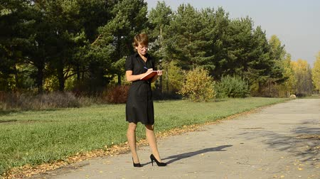 career path : Business woman in autumn park