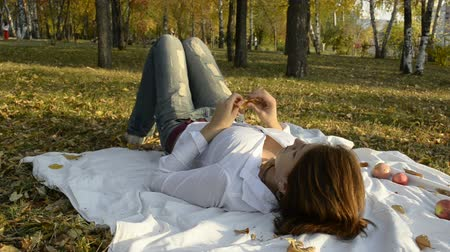 ремень : The young woman turned on bedspread in autumn park