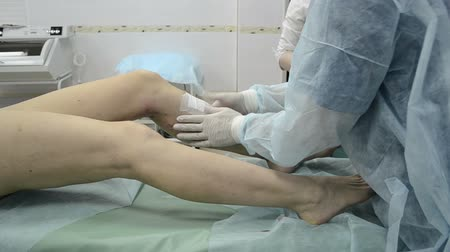 cerrahi : After Medical injection patient leg. Dressing compression hosiery. Sclerotherapy procedure