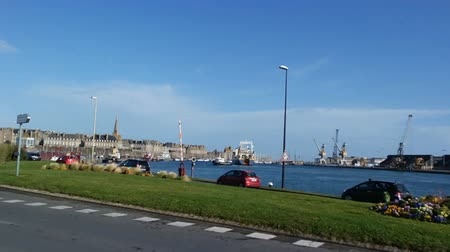 st malo : SAINT MALO, FRANCE - March 25, 2016: view of City wall view from the town. Cars driving on a road near a sea port Stock Footage