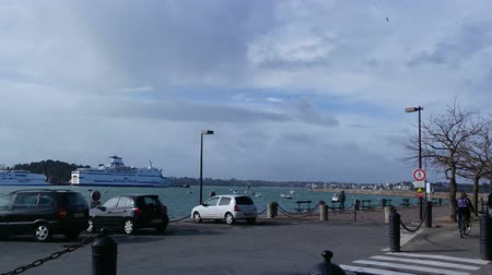 st malo : Cars driving on a road near a sea port Stock Footage