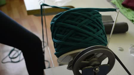 meada : Young woman working in a small yarn production workshop