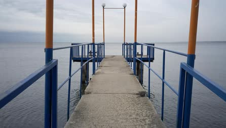Marine coastal landscape in fall. Small pier for yachts Stock mozgókép