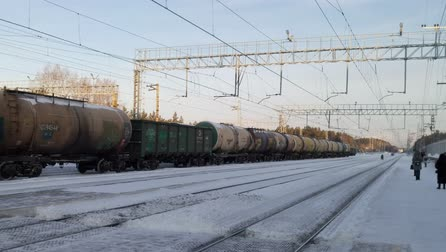 Railway goes into the distance. A major railway station for freight and passenger trains in Novosibirsk in winter