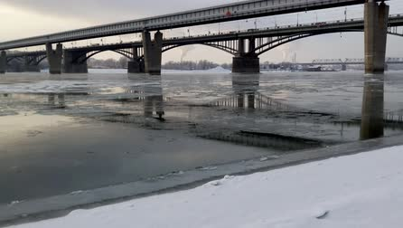 ледниковый : River Ob in Siberia on a cold winter day. Two bridges across the river.