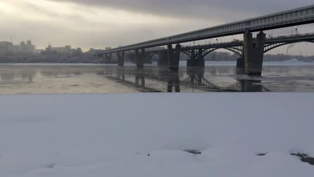 metro : River Ob in Siberia on a cold winter day. Two bridges across the river.