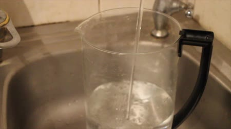 unfilled : Pouring water into a transparent carafe Stock Footage
