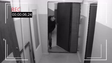 thieve : a young man passing by the open door,decided to steal a wing off of a Bicycle from the hallway Stock Footage