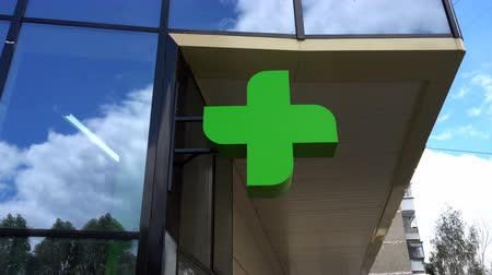 dispensary : EUROPEAN PHARMACY SIGN: The green cross, often animated, is a symbol found in many countries in Europe.