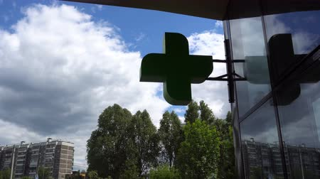 dispanser : EUROPEAN PHARMACY SIGN: The green cross, often animated, is a symbol found in many countries in Europe.