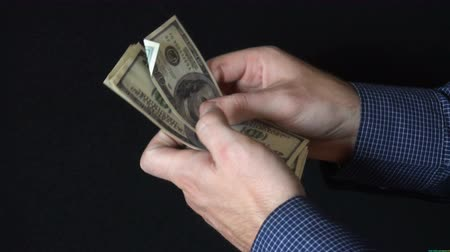 stash : Taking Money Out of a wallet. The man opens a leather wallet and pulls out a 100 dollar bills. slow motion
