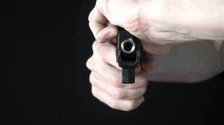 bulletproof : the young man reloads gun black.slow motion