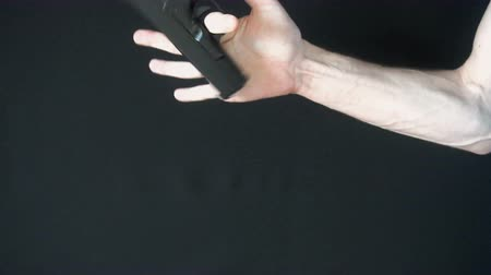 bulletproof : the young man turns on his finger gun black. slow motion Stock Footage