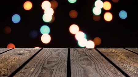 raflar : Perspective wood and bokeh background of night and the shimmering glare of the lights. display template item.