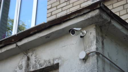 rioting : surveillance camera on the wall of childrens art school.
