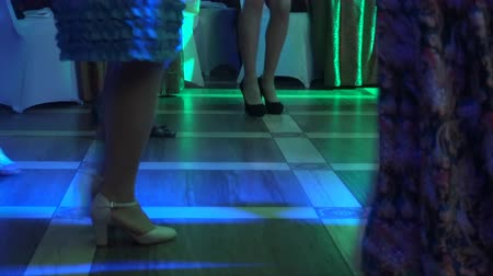 Cropped image of peoples feet dancing on a floor . Stock Footage